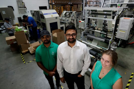 (From left) Achyut Patel, director of operations, Rudy Patel, director of business development an Katrina Hart, business development coordinator, pose for a picture at beyond Green, a maker of biodegradable bags in Lake Forest, Calif.
