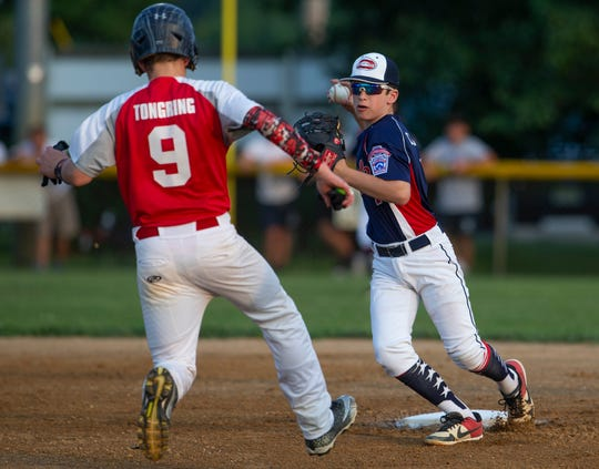 North Howell's Nick Cardone tries for a double play as Ocean's Connor Tongring tries to break it up. North Howell defeats Ocean in District 11 Little League Championship game in Howell, NJ on July 9, 2019.