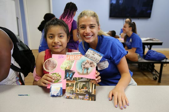 (right) Teona Iarajuli of Hoboken, a student from Hackensack Meridian Health Medical School at Seton Hall, works with Emeli Mendez, 10, of Asbury Park on her vision board during a visit with children at the Boys and Girls Club of Asbury Park in Asbury Park, NJ Wednesday July 10, 2019. Students from Hackensack Meridian Health Medical School at Seton Hall are fanning out into communities to figure out ways to improve health beyond the traditional doctors' offices.