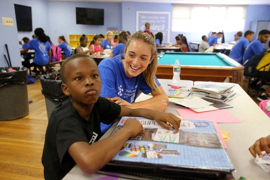 Lauren Valentine of Milford, CT, a student from Hackensack Meridian Health Medical School at Seton Hall, jokes around with Ny'John Kirkpatrick, 11, of Asbury Park during a visit to the Boys and Girls Club of Asbury Park in Asbury Park, NJ Wednesday July 10, 2019. Students from Hackensack Meridian Health Medical School at Seton Hall are fanning out into communities to figure out ways to improve health beyond the traditional doctors' offices.