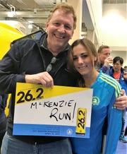 McKenzie Fergus with dad Dan, a former high school champion runner, after her completion of the Boston Marathon.