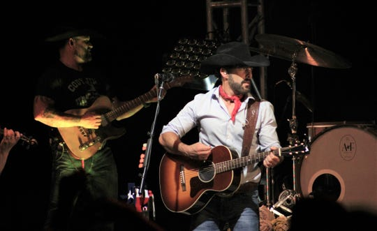 "Aaron Watson wore his red bandana for the Big Lake show Saturday, at which he played songs from his new album, ""Red Bandana."""