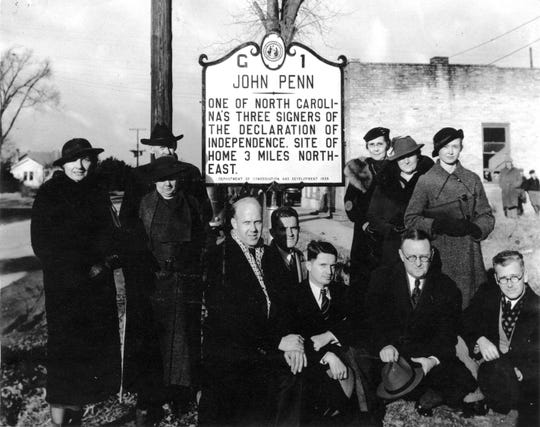This Jan. 10, 1936 photo provided by the State of North Carolina shows the dedication of North Carolina's first historical highway marker to John Penn, who signed the U.S. Declaration of Independence.  While this marker still stands, six others are missing. Officials say the markers are disappearing faster than the state can afford to replace them. (State of North Carolina via AP)