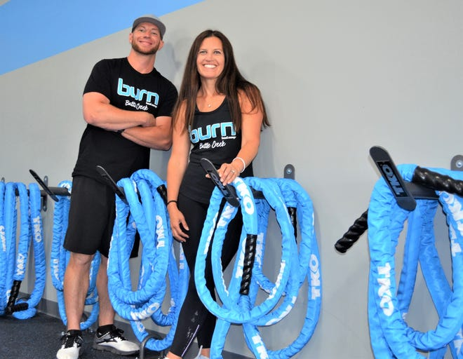 Burn Boot Camp will open its doors officially Monday in Battle Creek, led by local franchise partner Megan Johnson (right) and head trainer Ray Yager.