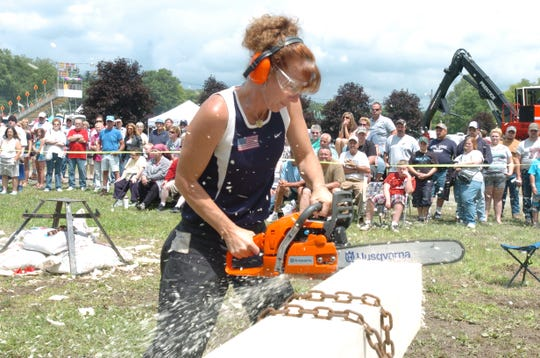 Andrea Robarge, from Naples, competes in the chain saw contest at the annual Deposit Lumberjack Festival.