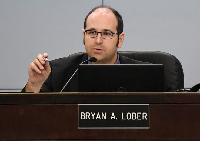 County Commissioner Bryan Lober answers critics during Tuesday's county commission meeting in Viera.f