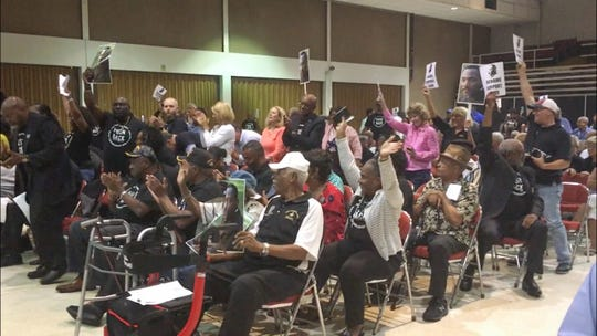 Audience members react as the Melbourne City Council votes 6-1 to rename Airport Boulevard after Dr. Martin Luther King Jr. on Tuesday July 9,  2019.