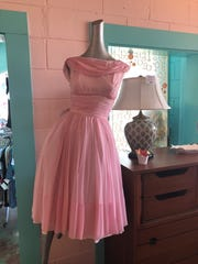 A 1960s vintage dress displayed at Astronaut's Wife. This dress would have been worn out to a cocktail or formal event during the era.