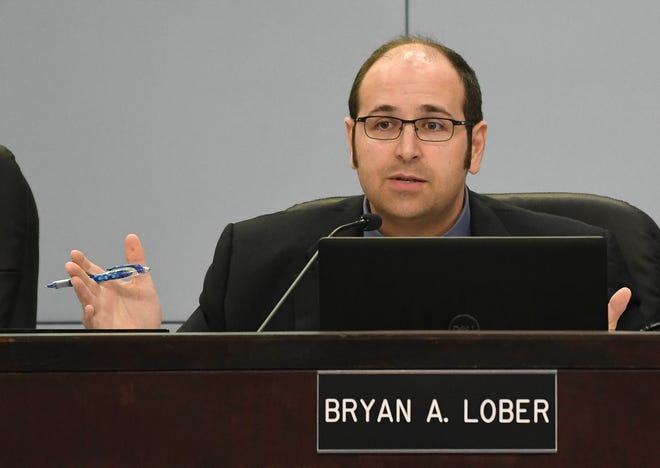 County Commissioner Bryan Lober speaks during Tuesday's county commission meeting in Viera.