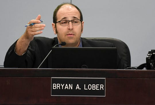 County Commissioner Bryan Lober answers critics during a recent commission meeting in Viera.