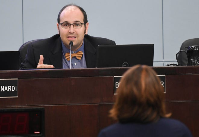 County Commission Vice Chair Bryan Lober addresses the concerns of Cocoa resident Mel Martin during Tuesday's County Commission meeting in Viera.