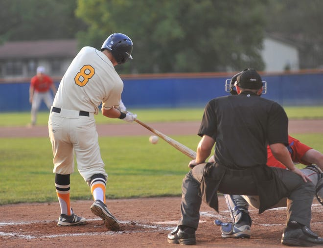 Graders utility player Garrett Kuns swings at a pitch against the Muskegon Clippers.
