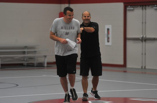 South Central head coach Brett Seidel (right) and Willard head coach Joe Bedingfield share a laugh during the Next Level Basketball 419 Camp on Wednesday morning at Buckeye Central High School.