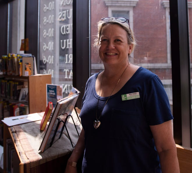 Director of the Fletcher Free Library Mary Danko stands in front of a row of books in the Burlington, VT, library July 9, 2019.