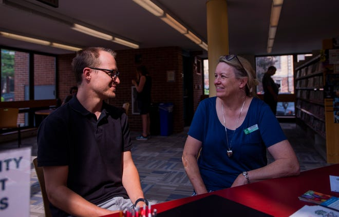 Library Director Mary Danko sits with a Howard Center employee July 9, 2019, in the Fletcher Free Library, Burlington, VT.