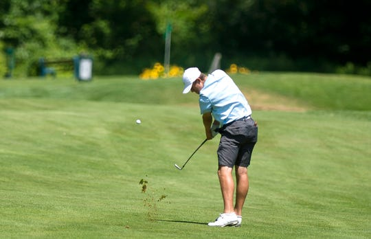 Bryson Richards connects on his approach shot at the par-4 16th hole at Rutland Country Club during the second round of the 2019 Vermont Amateur on Wednesday, July 10.