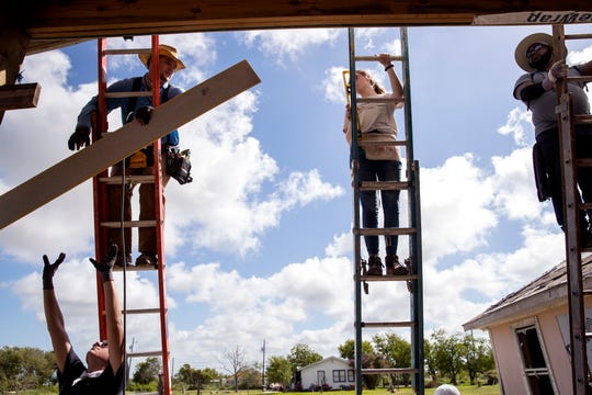 Marshall Roberts, clockwise from bottom left, 19, Daniel Flowers, Jenny Claus, 16 and The Rev. Bobby Hicks Jr. install siding on the side of a home that was damaged during Hurricane Harvey in Aransas Pass on Wednesday, July 10, 2019. They were a few of several students from middle school to college who were participating in a BOUNCE mission, which offers students an opportunity to help communities dealing with long-term disaster recovery.