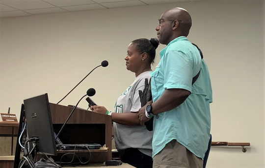 Kiwana Denson, left, and Terrance Denson speak to Nueces County Commissioners on July 11, 2019 about the importance of raising awareness on rip currents. They are the parents of Je'Sani Smith, who drowned in April after being caught in a rip current near Bob Hall Pier.