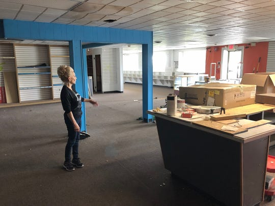 Janet Giordano, executive director of the Cherry Hill Food Pantry, offers a look at the building the nonprofit has rented at a reduced rate. The property at 41 Coles Ave. requires repairs to the ceiling, floor and other areas before it can open to the public.