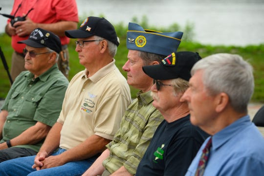 Vietnam Veterans listen this week to a Camden County announcement of four days of  commemorative events to be held in September for veterans of the Vietnam War.