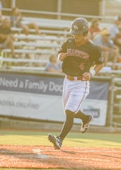 Gavin Homer scores a run in the Paints 4-3 win over the West Virginia Miners at VA Memorial Stadium on Tuesday.