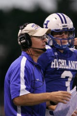 Taken in 2010: Highlands High School coach Dale Mueller directs quarterback Will Bardo during a game. Mueller was recently named the 2010 Russell Athletic National Coach of the Year.