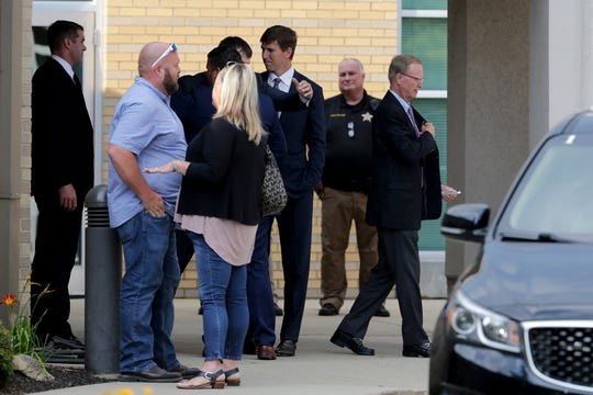 New York Giants quarterback Eli Manning, center, and owner John Mara, far right, leave after the visitation of former Highlands, University of Kentucky and New York Giants quarterback Jared Lorenzen, who had been hospitalized since June 28 with an infection plus heart and kidney issues, Wednesday, July 10, 2019, at St. Pius X Catholic Church in Edgewood, Ky.