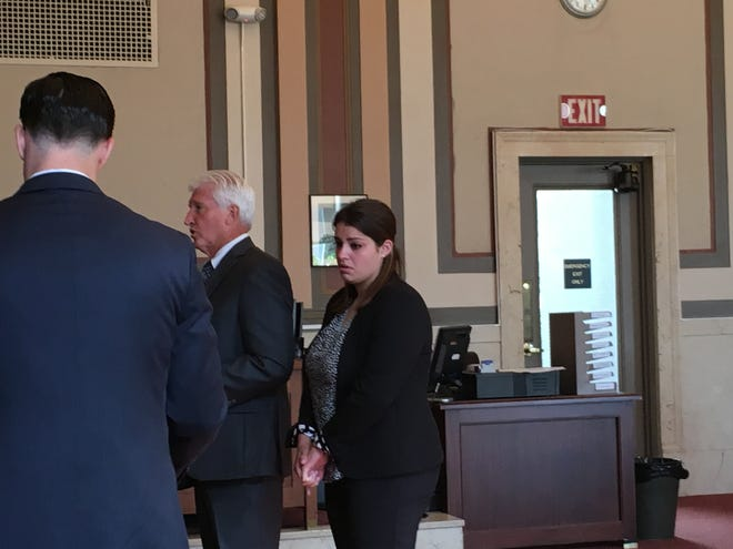 Jennifer Walsh stands beside her attorney, Stew Mathews, in Hamilton County Common Pleas Court on Wednesday, July 10, 2019.
