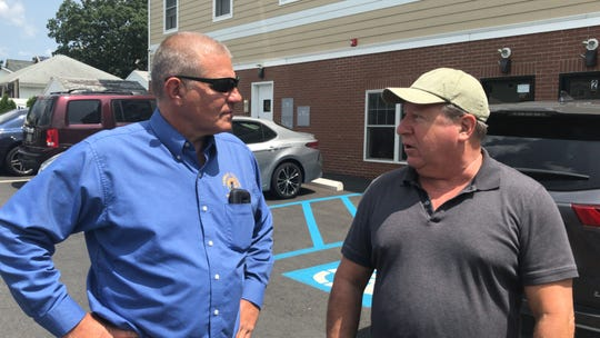 Franklin Township Economic Development Director Vincent Dominach chats with Recon Services owner Perry Pavicic about student housing projects coming to the Hamilton Street Special Improvement District.