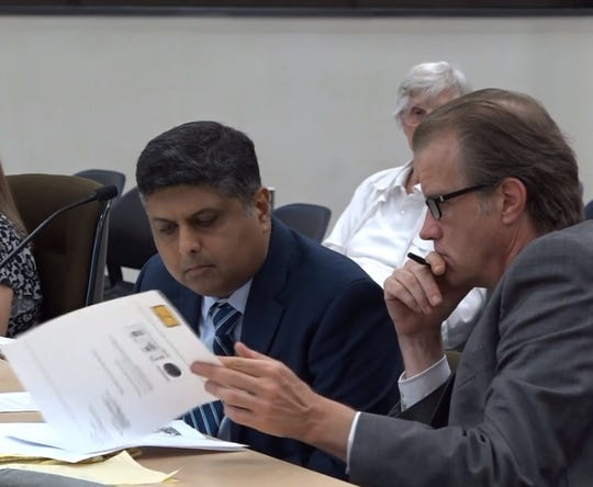 Mahesh Bhagia, left, with his attorney, Frank Fusco, testifying before the Edison Township committee of the whole on Monday, July 8.