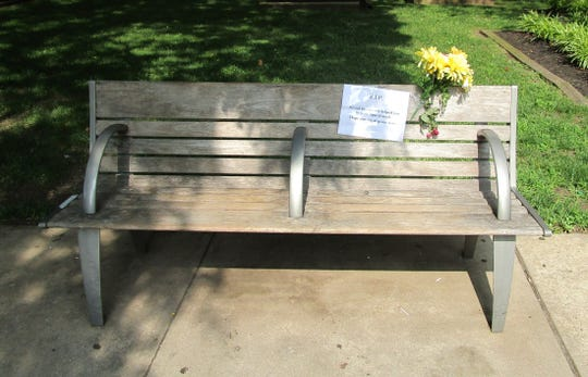 New Brunswick park bench on the 300 block of George Street where a woman was found deceased on Monday.