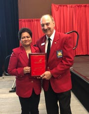 Pratima Patil receives SkillsUSA's Outstanding Career and Technical Educator award from SkillsUSA Executive Director Tim Lawrence during the 55th annual SkillsUSA National Leadership and Skills Conference held in Louisville, Kentucky.