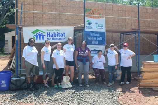 (Left to right) Judith Brown, Martina Ceselka, Ann Marie Dlugos, Kim Shulack, Anita Fredericks (homeowner), Nancy Rizzo, Antoinette Marrero and Patricia Kerster.