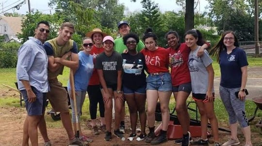 Youth leaders, pictured with Bound Brook Councilman Abel Gomez on far left, are revitalizing a neglected park to make a positive change in their community.