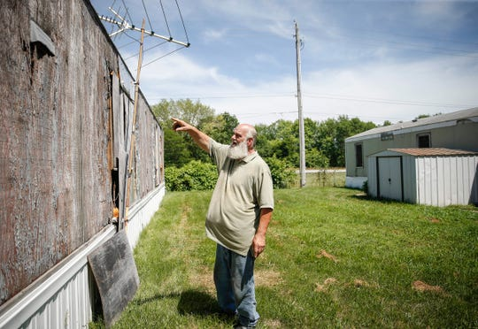 Al Warren points to the heavily deteriorated walls of his mobile home on Wednesday, July 3, 2019, in Indianola.