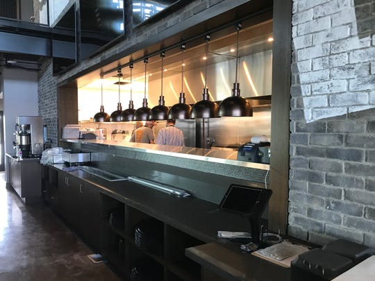The Burger Shed, a new restaurant in Altoona, features an open kitchen area that looks out to the restaurant's seating area.
