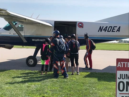 A Des Moines Skydivers group boards a plane before their jump at the Winterset airport.