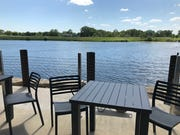 Burger Shed's patio looks out onto the lake at Altoona's Shoppes at Prairie Crossing area.