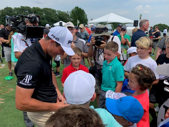PGA Tour golfer Viktor Hovland signs autographs for children following The First Tee's youth clinic Tuesday afternoon at the John Deere Classic at TPC Deere Run in Silvis, Illinois.