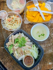 Khao man gai (Thai-style Hainanese chicken), green papaya salad and mango & sticky coconut rice from the Midwest Buddhist Meditation Center's Sunday market in Warren.