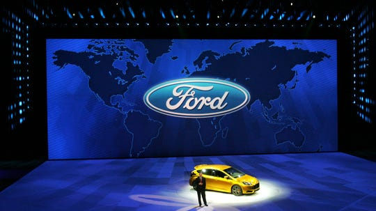 Ford president and CEO Alan Mulally talks to the media in front of the Ford Focus ST during the Ford press conference at Cobo Arena at the 2011 North American International Auto Show held at Cobo Center on Monday, January 10, 2011.