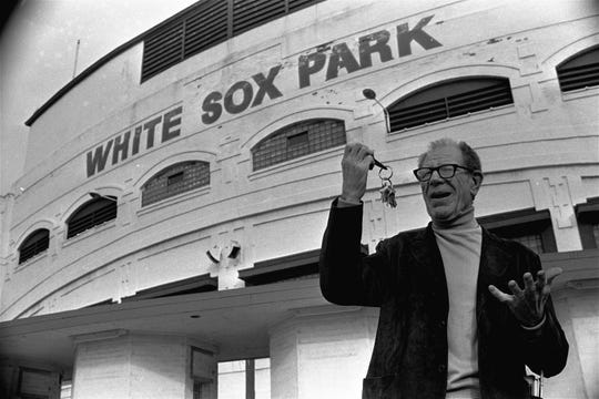 "Bill Veeck, new owner of the Chicago White Sox, clowns as he stands outside the White Sox ball park holding the keys to the park, December 16, 1975.  Veeck was heard to say, ""It's all mine."""
