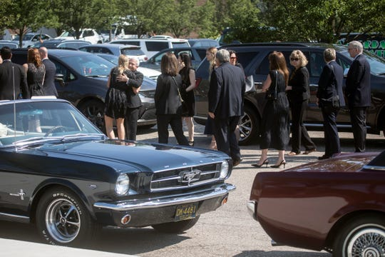 Mourners gather for funeral services for automobile executive Lee Iacocca at St. Hugo of the Hills in Bloomfield Hills, Mich., Wednesday, July 10, 2019.