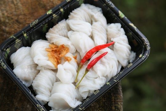 Khao kriab pak moh, Thai-style steamed rice paper dumplings, from the Midwest Buddhist Meditation Center's Sunday market in Warren on July 7, 2019.