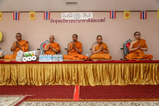 From left: Ajahn Thanaphat Tukaeo, Ajahn Thanomsak Choomjun, Ajahn Prayard Dhammagamo, Ajahn Mongkol Ngamsub and Ajahn Prawed Paklang, monks of the Midwest Buddhist Meditation Center in Warren.