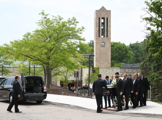 Lee Iacocca's casket is moved to a waiting Chrysler hearse Wednesday after a funeral mass at St. Hugo of the Hills Church in Bloomfield Hills.