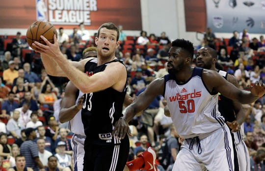Matt Costello, left, drained three 3-pointers in the Pistons' Summer League win over the 76ers on Wednesday.