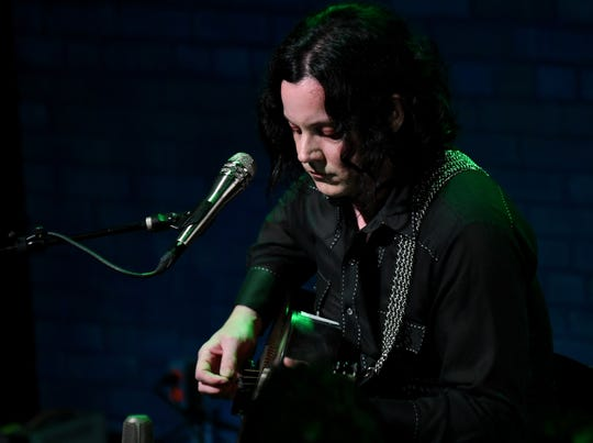Jack White performs an acoustic set at Third Man records in July.