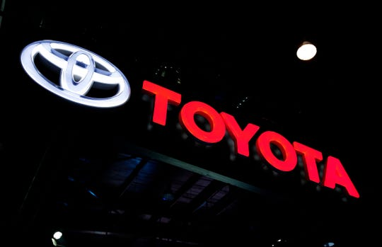 In this Feb. 7, 2018, file photo the logo of Toyota is displayed at the Auto Expo in Greater Noida, near New Delhi, India.