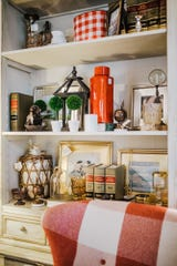 Don't be afraid to layer your shelf items.